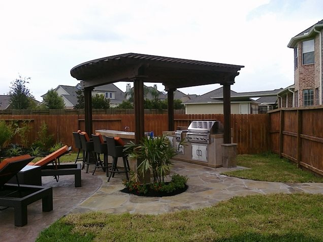 Backyard Escapes Landscaping : Grill pergola backyard barstoolsflagstonerockfrog