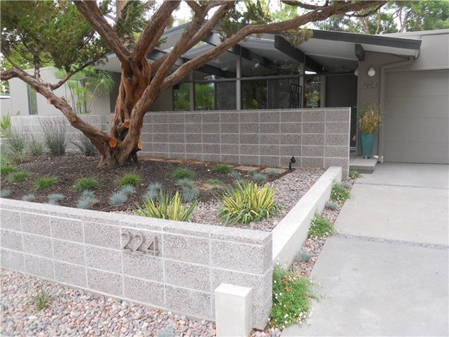 landscaped to complement a mid century modern home this front yard