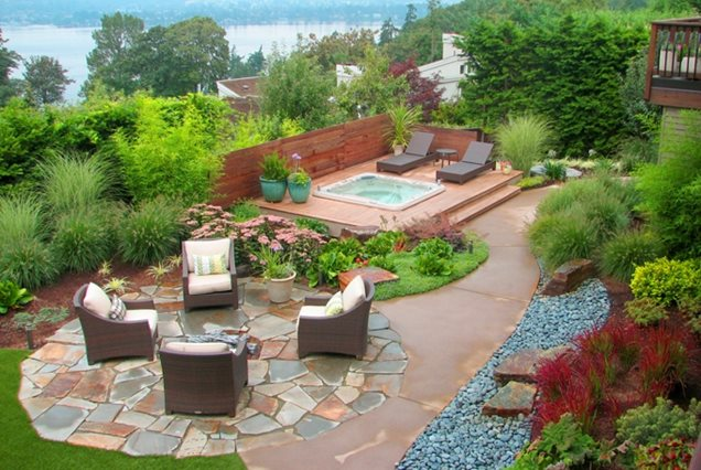 Different paving materials designate distinct areas in this backyard ...