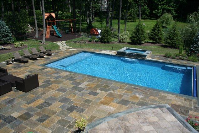 Large Backyard Pool Ideas : This large swimming pool features bluestone coping and Chinese granite