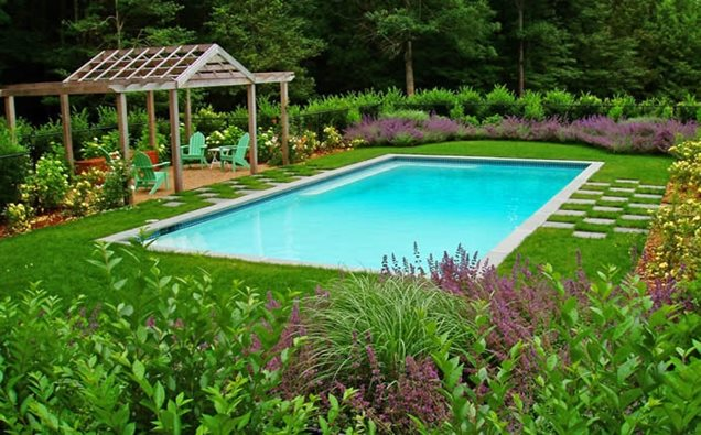 Landscape design swimming pool modern home exteriors for Swimming pool landscaping ideas