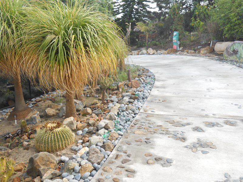 Concrete Driveway, River Rock, Embeds Concrete Paving Landscaping Network Calimesa, CA