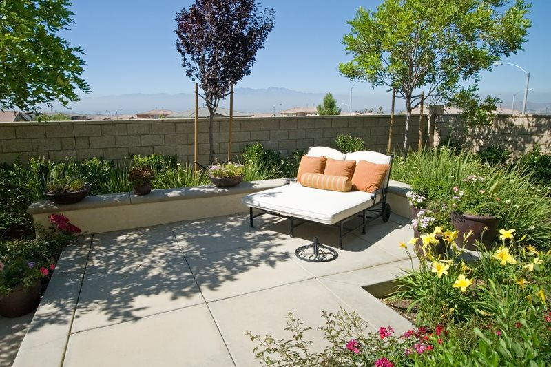 Small Concrete Patio, Double Chaise Lounge Concrete Paving Landscaping Network Calimesa, CA