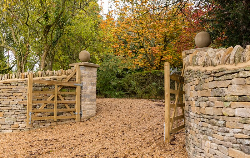 Rustic Gravel Driveway, Swinging Gate, Stone Walls Country Landscape Design Landscaping Network Calimesa, CA