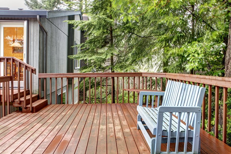Brown Wood Deck, Evergreen Trees, Blue Bench Deck Design Landscaping Network Calimesa, CA