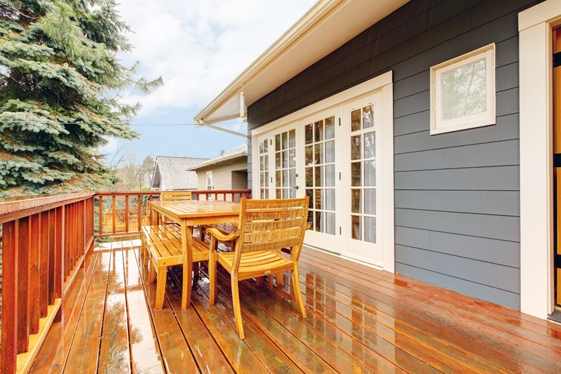 Second Story Deck After Rain, Teak Furniture Deck Design Landscaping Network Calimesa, CA