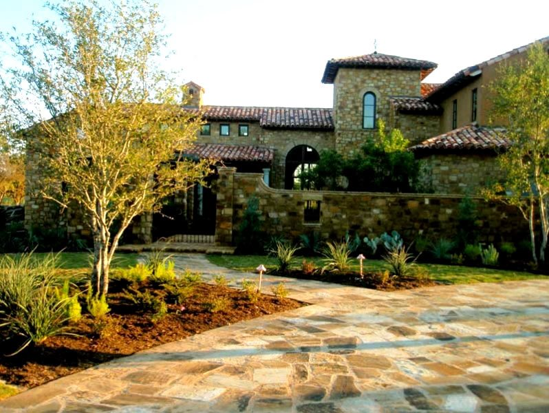 Flagstone Driveway, Stone Wall, Metal Gate Front Yard Landscaping GreenScapes Landscaping and Pools Austin, TX