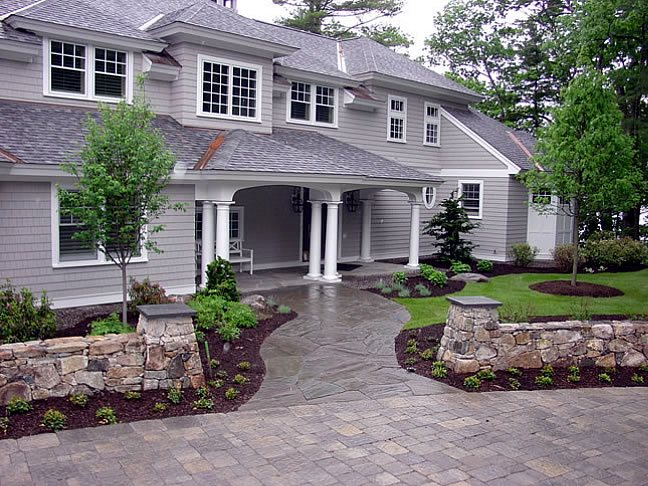 Front Flagstone Walkway, Entrance Walls Front Yard Landscaping Belknap Landscape Co., Inc. Gilford, NH