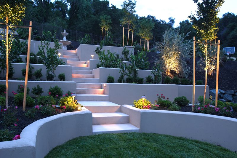 Terraced hillside stucco walls lighting landscaping network calimesa ca