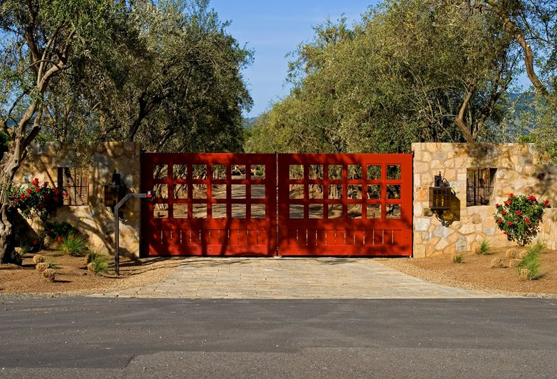 Red Driveway Gate, Olive Trees, Stone Wall Mediterranean Landscaping Landscaping Network Calimesa, CA