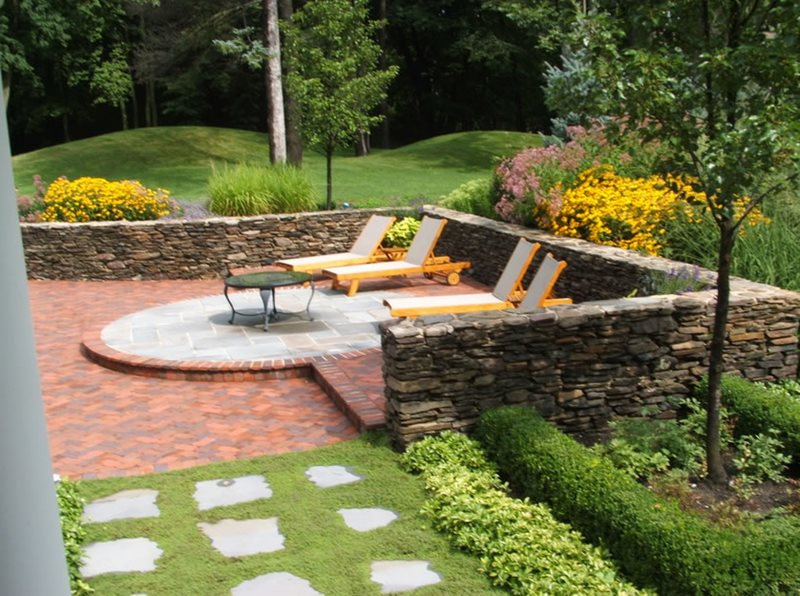 Brick Patio, Chaise Lounges, Stone Walls Midwest Landscaping Milieu Design Wheeling, IL