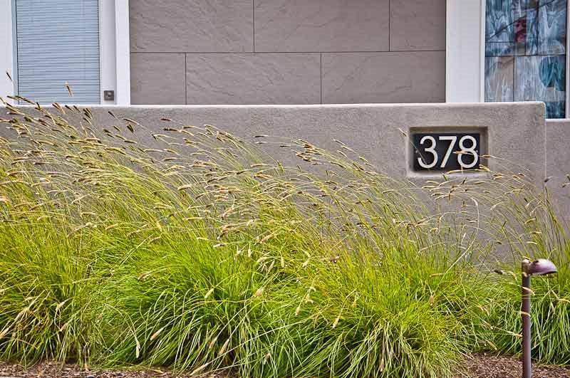 Modern Front Yard Wall, Address Marker, Ornamental Grasses Modern Landscaping Ecotones Landscapes Cambria, CA