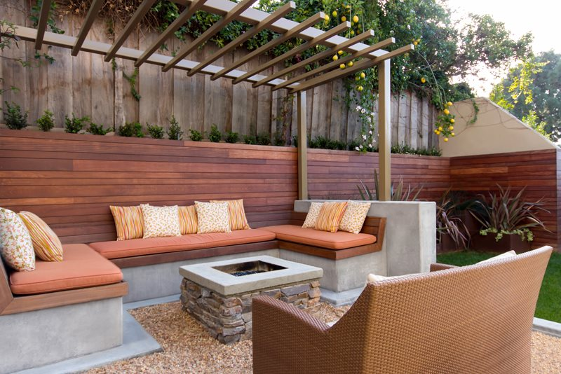 Square Stone Fire Pit, Concrete Cap, Buil In Bench Seating, Metal Pergola Modern Landscaping Studio H Landscape Architecture Newport Beach, CA