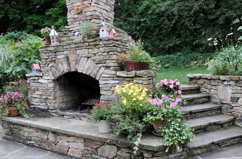 eclectic stone backyard fireplace outdoor fireplace brown design group new stanton pa - Patio Fireplace Designs