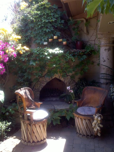 Equipale Chairs, Ivy Covered Fireplace Outdoor Fireplace Art Effects Escondido, CA