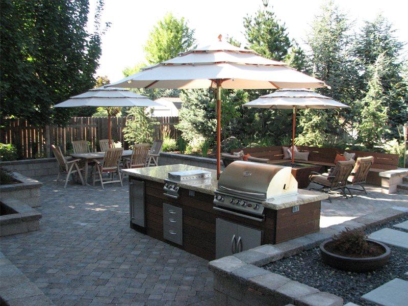 Wood, Granite, Grill, Umbrella Outdoor Kitchen Breckon Land Design Inc. Garden City, ID