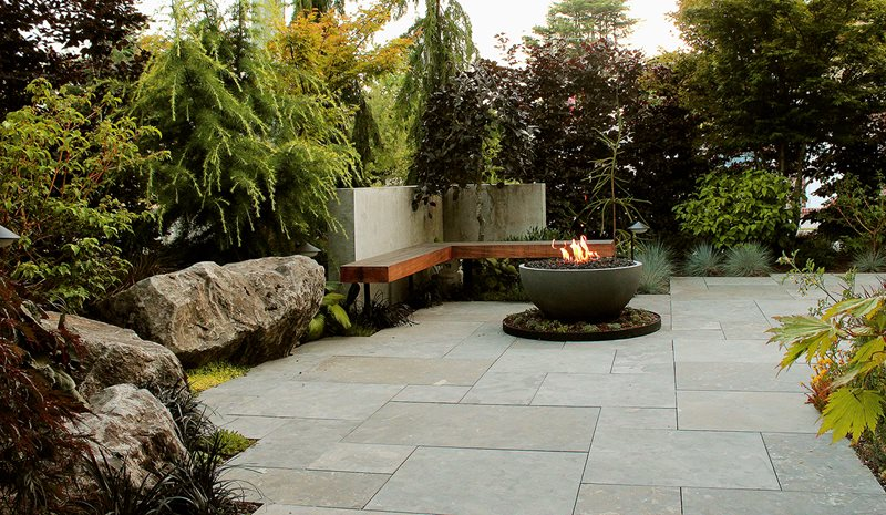 Boulder Seating, Limestone Patio, Firebowl, Cedar Bench Patio Green Elevations North Vancouver, British Columbia