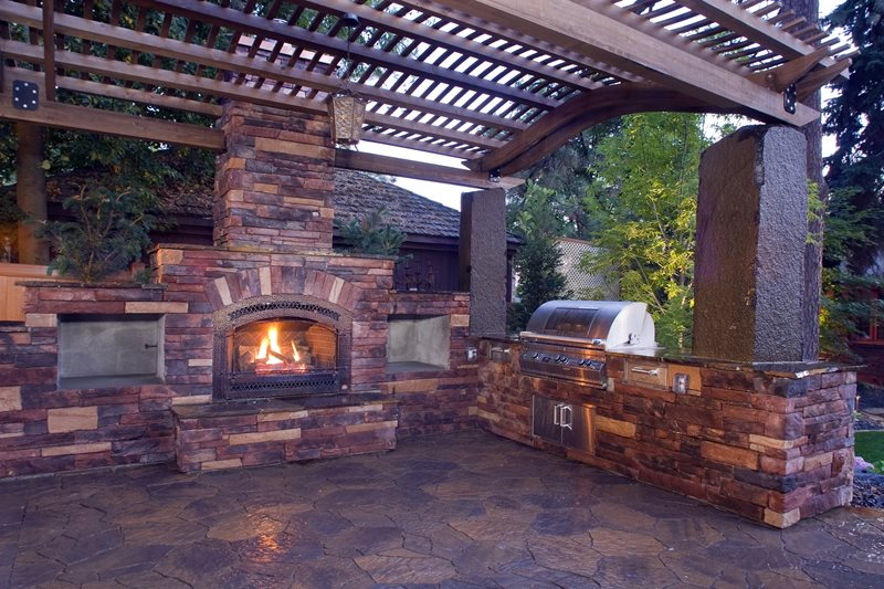 Outdoor Kitchen And Fireplace Pergola and Patio Cover Copper Creek Landscaping, Inc. Mead, WA