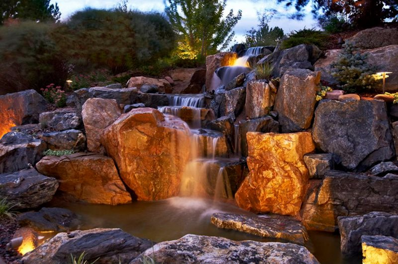 Naturalistic Rock Waterfall Lighting Pond and Waterfall American Design & Landscape Parker, CO