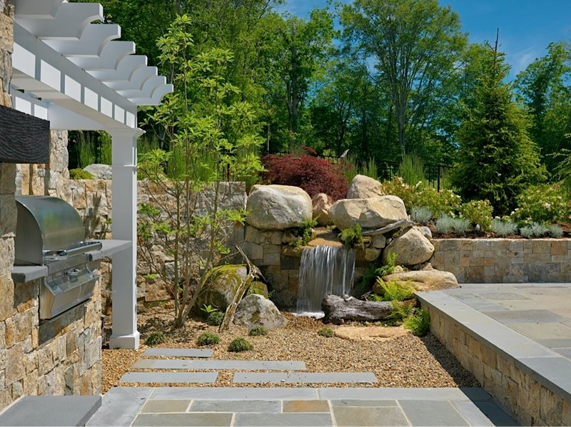 Waterfall Landscape Design Ideas this pond sits in the center of an enormous garden and features a two tiered Pondless Rock Waterfall Pond And Waterfall Yard Boss Landscape Design Llc Mattapoisett Ma