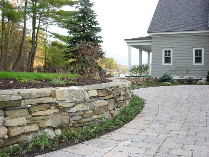 Dry Laid Stone Retaining Wall Retaining and Landscape Wall Belknap Landscape Co., Inc. Gilford, NH