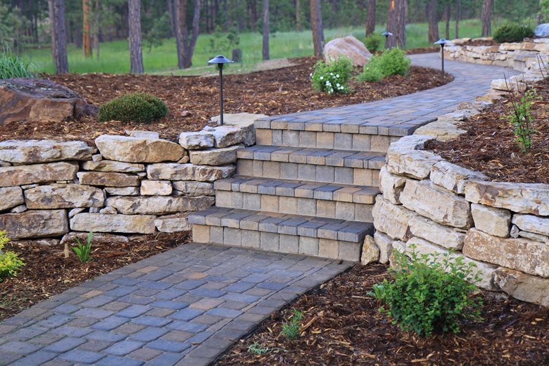 Dry Stack Stone Wall, Brown Paver Walkway Retaining and Landscape Wall Landscaping Network Calimesa, CA