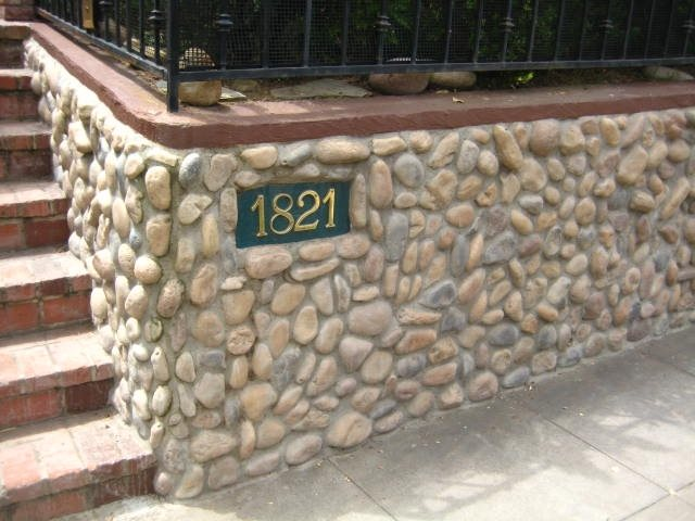 Entry Wall With Smooth Stone Retaining and Landscape Wall Landscaping Network Calimesa, CA