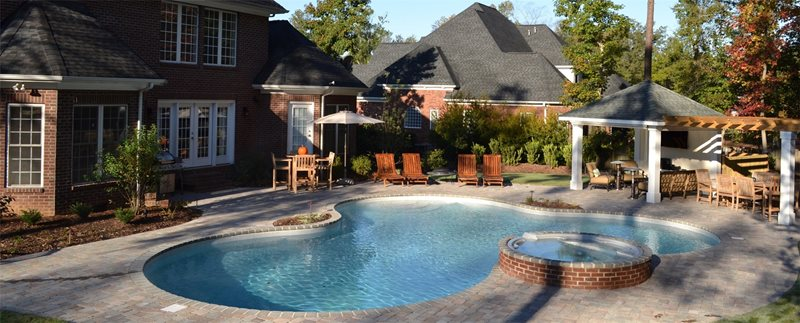 Freeform Pool, Raised Spa, Coping Planter, Brick, Pavers Swimming Pool TG&R Landscape Group Charlotte, NC