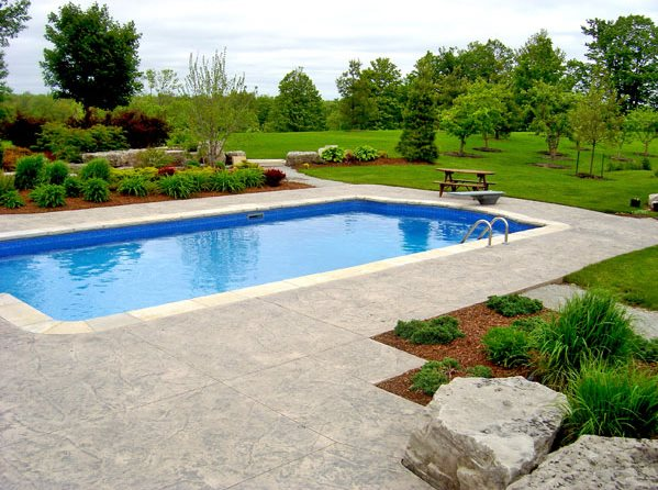 Roman Pool Design, Stamped Concrete Swimming Pool Renaissance Landscape  Group Inc Puslinch, ON
