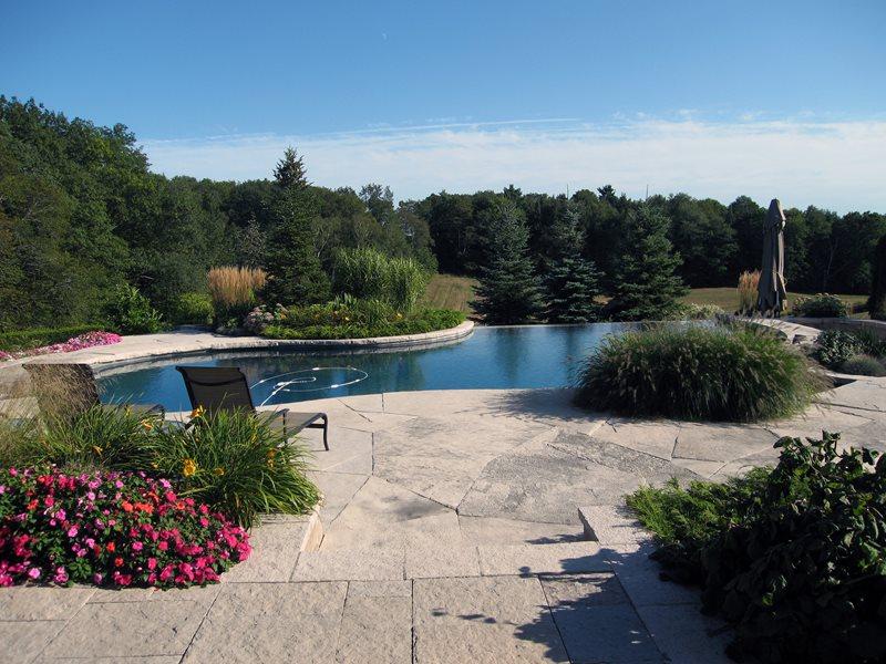 Vanishing Edge, Stone Deck Swimming Pool Landscaping Network Calimesa, CA