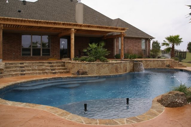 Free Form Swimming Pool Tropical Landscaping Landvisions TX Tyler, TX