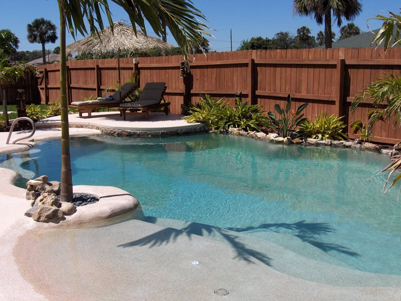 Tropical pool calimesa ca photo gallery landscaping for Pool design with beach entry