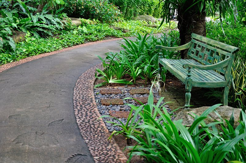 Tropical Path, Leaf Imprints, Pebble Border, Teak Bench Walkway and Path Landscaping Network Calimesa, CA