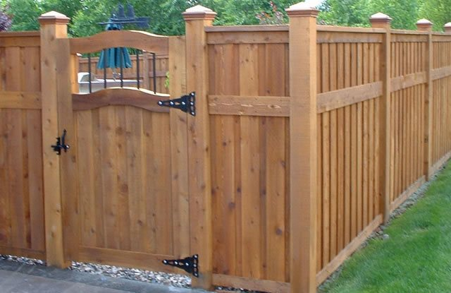 Backyard fencing ideas landscaping network Wood garden fence designs