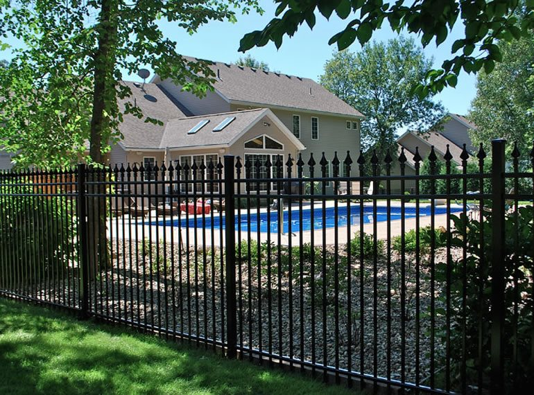 Backyard fencing ideas landscaping network for How to build a swimming pool fence