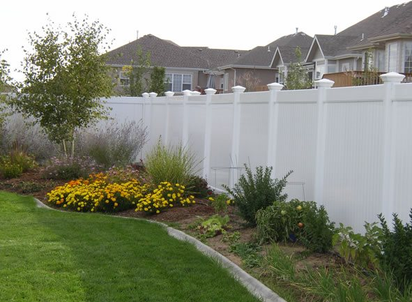 Backyard fencing ideas landscaping network for Landscaping ideas with fences