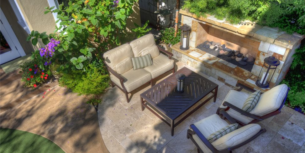 Landscape Design For Small Backyards old fashioned metal chaise and side table on stone flooring in small backyard ideas Low Fireplace Small Yard Landscaping Z Freedman Landscape Design Venice Ca