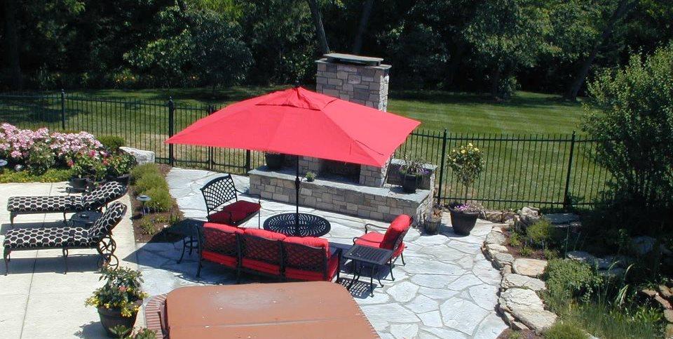 Backyard Living, Spa Surround, Stone Fireplace Backyard Landscaping Landscape Concepts St. Louis, MO