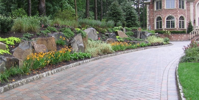 Driveway Design Ideas photo of an expansive traditional driveway in new york with gravel for spring Stone Driveway Edging Cipriano Landscape Design Mahwah Nj